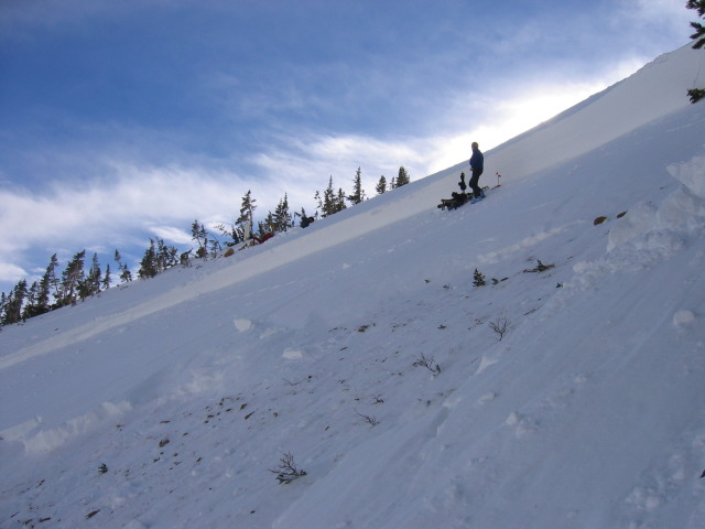 <b>Figure 5:</b> Looking east from western flank of path. The slope angle at the crown was 35 degrees. One of the accident investigators at the crown for scale. (<a href=javascript:void(0); onClick=win=window.open('http://avalanche.state.co.us/caic/media/full/acc_225_309.jpg','caic_media','resizable=1,height=820,width=840,scrollbars=yes');win.focus();return false;>see full sized image</a>)