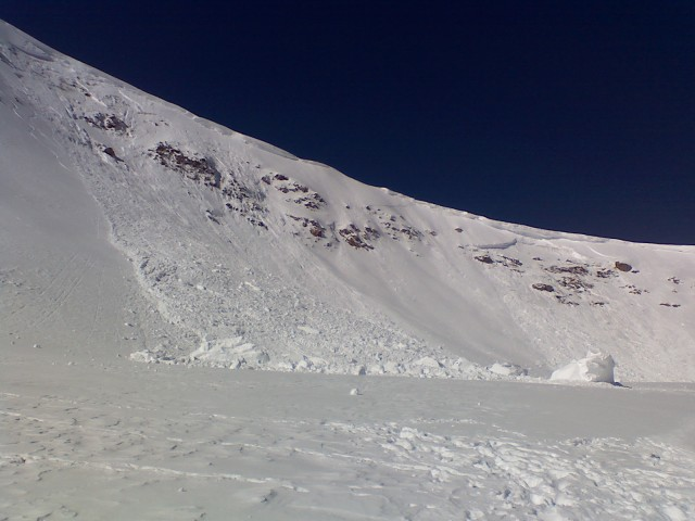 <b>Figure 2:</b> The debris field from below. Note the huge cornice chunks, and the previous avalanche in the background (Photo taken 01/11) (<a href=javascript:void(0); onClick=win=window.open('https://avalanche.state.co.us/caic/media/full/acc_41_129.jpg','caic_media','resizable=1,height=820,width=840,scrollbars=yes');win.focus();return false;>see full sized image</a>)