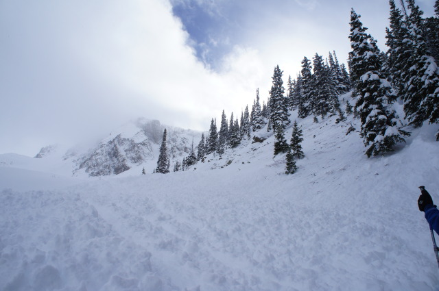 <b>Figure 3:</b> Approximately 10 to 20 feet above this photo location is where Rider 1 was caught. The avalanche swept out of the lateral moraine on the right side of the image. (<a href=javascript:void(0); onClick=win=window.open('https://avalanche.state.co.us/caic/media/full/acc_484_3963.jpg','caic_media','resizable=1,height=820,width=840,scrollbars=yes');win.focus();return false;>see full sized image</a>)
