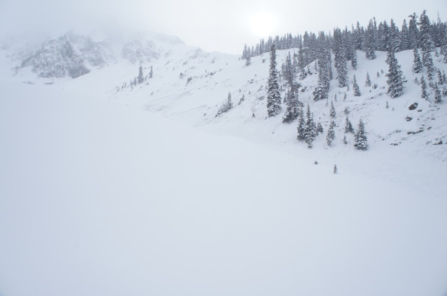 <b>Figure 5:</b> Coyote Tooth in the clouds to the top left of image. Fracture from the earlier Coyote Tooth avalanche ran almost to timber on the center right of photo (<a href=javascript:void(0); onClick=win=window.open('https://avalanche.state.co.us/caic/media/full/acc_484_3965.jpg','caic_media','resizable=1,height=820,width=840,scrollbars=yes');win.focus();return false;>see full sized image</a>)