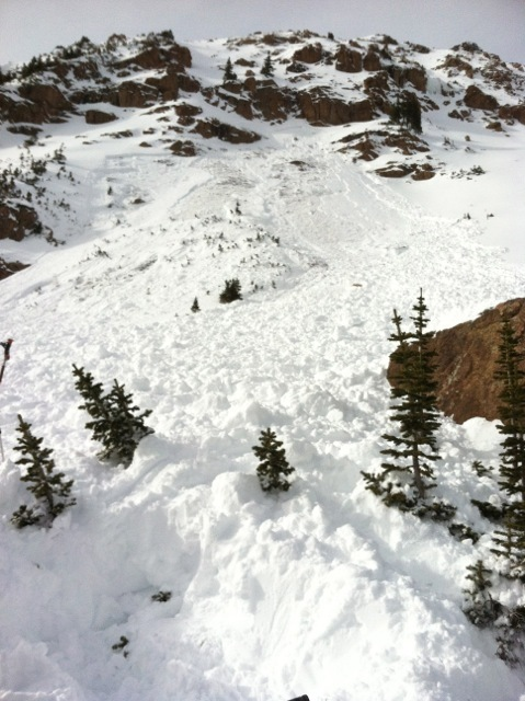 <b>Figure 2:</b> Looking up the avalanche path. Several group members took shelter behind the boulder in the right of the photograph. (<a href=javascript:void(0); onClick=win=window.open('https://avalanche.state.co.us/caic/media/full/acc_487_4137.jpg','caic_media','resizable=1,height=820,width=840,scrollbars=yes');win.focus();return false;>see full sized image</a>)