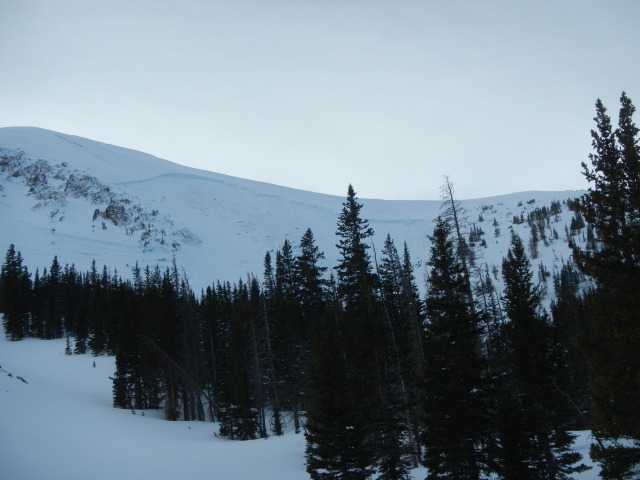 <b>Figure 7:</b> A view of the crown of the avalanche. Ski tracks are visible near the low point of the saddle. (<a href=javascript:void(0); onClick=win=window.open('https://avalanche.state.co.us/caic/media/full/acc_497_4671.jpg','caic_media','resizable=1,height=820,width=840,scrollbars=yes');win.focus();return false;>see full sized image</a>)