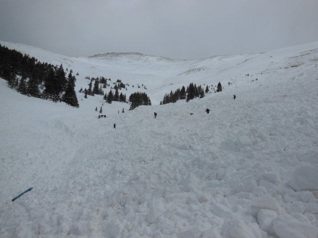 <b>Figure 12:</b> Looking up through the avalanche debris with rescuers in the path. Photo: Halsted Morris (<a href=javascript:void(0); onClick=win=window.open('https://avalanche.state.co.us/caic/media/full/acc_505_5134.jpg','caic_media','resizable=1,height=820,width=840,scrollbars=yes');win.focus();return false;>see full sized image</a>)