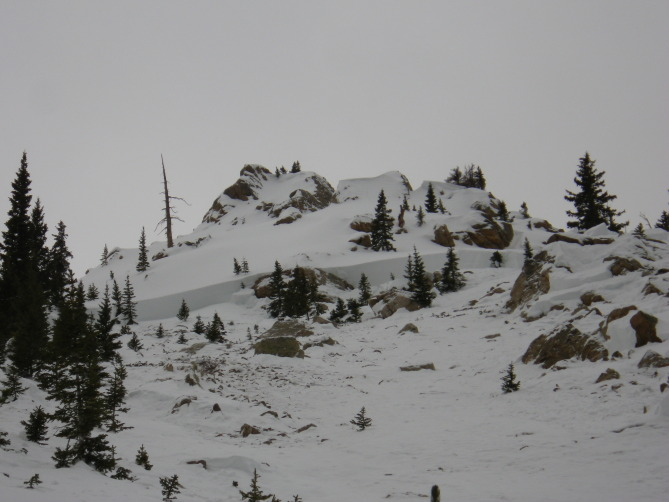 <b>Figure 6:</b> Looking up will at a deep portion of the crown face in the eastern portion of the Star Mountain A avalanche path. The group's snowpit is behind the trees in the left side of the image. (<a href=javascript:void(0); onClick=win=window.open('http://avalanche.state.co.us/caic/media/full/acc_526_7251.jpg','caic_media','resizable=1,height=820,width=840,scrollbars=yes');win.focus();return false;>see full sized image</a>)