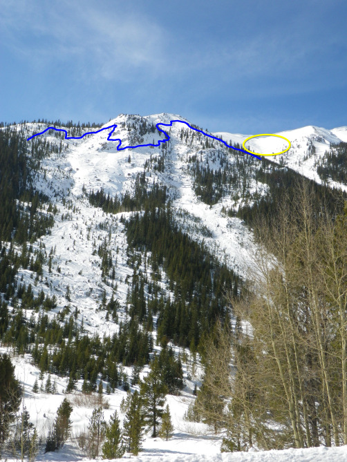 <b>Figure 11:</b> An overview of the Star Mountain A avalanche path. The blue line shows the approximate location of the crown face. The yellow circle shows the avalanche in the Star Mountain B avalanche path. (<a href=javascript:void(0); onClick=win=window.open('http://avalanche.state.co.us/caic/media/full/acc_526_7257.jpg','caic_media','resizable=1,height=820,width=840,scrollbars=yes');win.focus();return false;>see full sized image</a>)