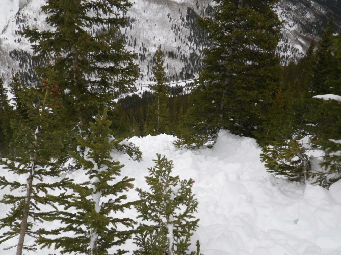 <b>Figure 15:</b> Looking down hill at avalanche debris. The image was taken uphill and to the east (skier's right) of were Riders 2 and 4 were buried. (<a href=javascript:void(0); onClick=win=window.open('http://avalanche.state.co.us/caic/media/full/acc_526_7261.jpg','caic_media','resizable=1,height=820,width=840,scrollbars=yes');win.focus();return false;>see full sized image</a>)