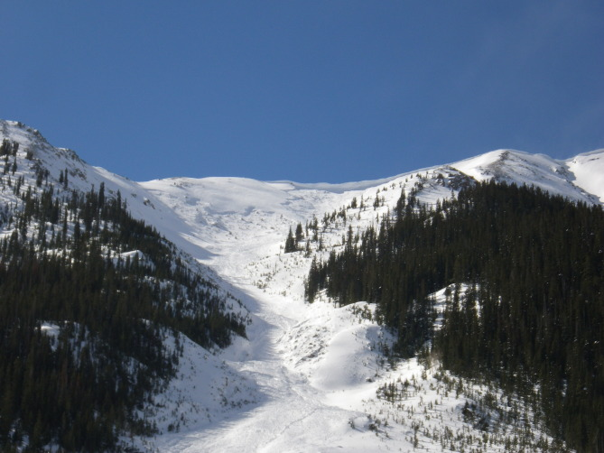 <b>Figure 24:</b> Looking up hill at the avalanche in Star Mountain B on February 17, 2014. This avalanche released naturally on February 13th or 14th. (<a href=javascript:void(0); onClick=win=window.open('http://avalanche.state.co.us/caic/media/full/acc_526_7272.jpg','caic_media','resizable=1,height=820,width=840,scrollbars=yes');win.focus();return false;>see full sized image</a>)