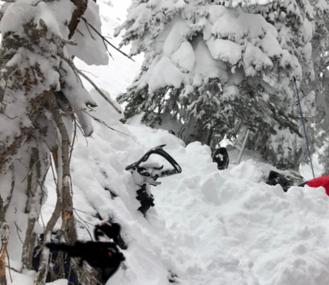 <b>Figure 5:</b> Rider 5's snowmobile after it was partially dug out. (<a href=javascript:void(0); onClick=win=window.open('http://avalanche.state.co.us/caic/media/full/acc_619_13825.jpg','caic_media','resizable=1,height=820,width=840,scrollbars=yes');win.focus();return false;>see full sized image</a>)