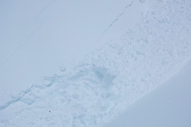 <b>Figure 3:</b> The location where the snowmobiler was buried in the gully feature. (<a href=javascript:void(0); onClick=win=window.open('http://avalanche.state.co.us/caic/media/full/acc_622_14107.jpg','caic_media','resizable=1,height=820,width=840,scrollbars=yes');win.focus();return false;>see full sized image</a>)
