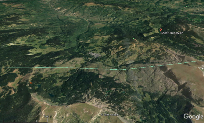 <b>Figure 1:</b> A Google Earth image of the area looking to the north toward Sheriff Reservoir. The turquoise line is the border between Rio Blanco and Garfield counties. The avalanche is shown in red in the lower left portion of the frame. (<a href=javascript:void(0); onClick=win=window.open('http://avalanche.state.co.us/caic/media/full/acc_631_15683.jpg','caic_media','resizable=1,height=820,width=840,scrollbars=yes');win.focus();return false;>see full sized image</a>)