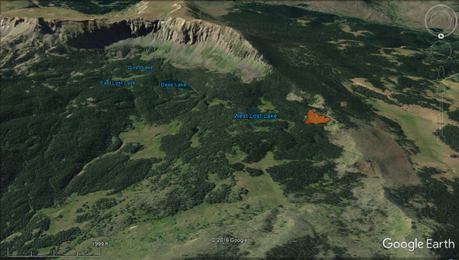 <b>Figure 2:</b> A Google Earth image looking south at Lost Lake Peaks. The avalanche is shown in red to the right of West Lost Lake. (<a href=javascript:void(0); onClick=win=window.open('http://avalanche.state.co.us/caic/media/full/acc_631_15684.jpg','caic_media','resizable=1,height=820,width=840,scrollbars=yes');win.focus();return false;>see full sized image</a>)