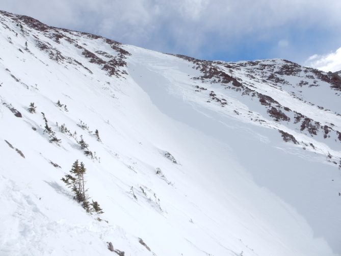 <b>Figure 4:</b> Looking uphill from a perspective partially down the slide path.  The avalanche was triggered in the top left corner of the photo.  The right to left cross-loading pattern is evident in this photo. (<a href=javascript:void(0); onClick=win=window.open('http://avalanche.state.co.us/caic/media/full/acc_632_15803.jpg','caic_media','resizable=1,height=820,width=840,scrollbars=yes');win.focus();return false;>see full sized image</a>)