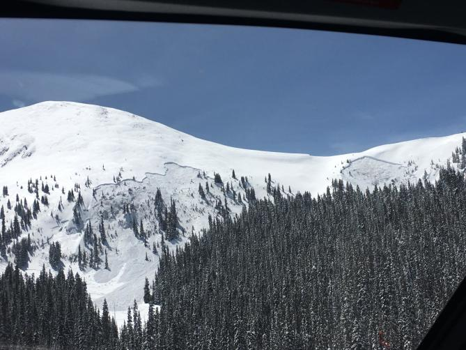 <b>Figure 1:</b> View of the fatal accident site. The snowmobiler was caught in the avalanche on the left of the image. The avalanche on the right side released sympathetically. (<a href=javascript:void(0); onClick=win=window.open('http://avalanche.state.co.us/caic/media/full/acc_666_20399.jpg','caic_media','resizable=1,height=820,width=840,scrollbars=yes');win.focus();return false;>see full sized image</a>)