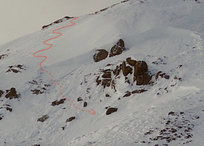 <b>Figure 3:</b> Looking up at the crown of the avalanche. The red curve shows the approximate location of Skier 1's descent. (Courtesy of Dale Atkins). (<a href=javascript:void(0); onClick=win=window.open('https://avalanche.state.co.us/caic/media/full/acc_681_22051.jpg','caic_media','resizable=1,height=820,width=840,scrollbars=yes');win.focus();return false;>see full sized image</a>)