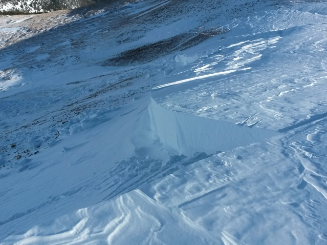 <b>Figure 3:</b> Mt. Trelease avalanche.  Probably triggered here.  Cracks propagate up where slope angle is too low for snow to move. Est. 11.21.15 (<a href=javascript:void(0); onClick=win=window.open('https://avalanche.state.co.us/caic/media/full/obs_36564_10334.jpg','caic_media','resizable=1,height=820,width=840,scrollbars=yes');win.focus();return false;>see full sized image</a>)
