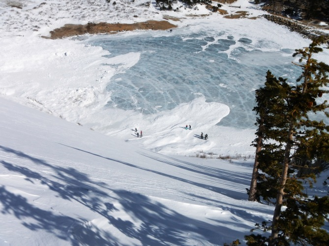 <b>Figure 1:</b> Looking down at avalanche debris that ran onto the lake. St. Mary's glacier. Note the concentric &quot;pressure wave&quot; rings in the ice out from debris piles. 1.16.16 (<a href=javascript:void(0); onClick=win=window.open('https://avalanche.state.co.us/caic/media/full/obs_38681_11342.jpg','caic_media','resizable=1,height=820,width=840,scrollbars=yes');win.focus();return false;>see full sized image</a>)