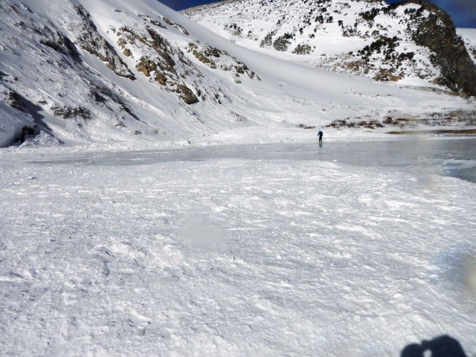 <b>Figure 10:</b> Looking north along the lake with debris lobes spread onto the ice. Deepest debris was on the north end. (<a href=javascript:void(0); onClick=win=window.open('https://avalanche.state.co.us/caic/media/full/obs_38681_11354.jpg','caic_media','resizable=1,height=820,width=840,scrollbars=yes');win.focus();return false;>see full sized image</a>)