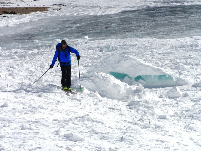 <b>Figure 11:</b> Lake ice block wrapped up in avalanche debris. CAIC forecaster for scale (<a href=javascript:void(0); onClick=win=window.open('https://avalanche.state.co.us/caic/media/full/obs_38681_11384.jpg','caic_media','resizable=1,height=820,width=840,scrollbars=yes');win.focus();return false;>see full sized image</a>)