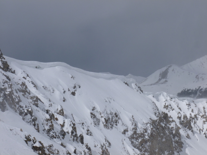 <b>Figure 1:</b> Cornices are growing and may collapse with a person's weight. We will need to give these cornices a wide berth. A cornice collapse could result in a long fall and could also trigger a subsequent avalanche on the slope. (<a href=javascript:void(0); onClick=win=window.open('https://avalanche.state.co.us/caic/media/full/obs_41222_12739.jpg','caic_media','resizable=1,height=820,width=840,scrollbars=yes');win.focus();return false;>see full sized image</a>)