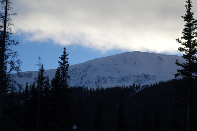 <b>Figure 1:</b> Looking up at South Diamond Peak, NE face, from the highway. The entire face slid on 12-24-2016. This is a very large and very scary avalanche. There are definitely other faces in the Front Range Zone with a similar structure that can produce equally large and dangerous avalanches. (<a href=javascript:void(0); onClick=win=window.open('https://avalanche.state.co.us/caic/media/full/obs_43762_14201.jpg','caic_media','resizable=1,height=820,width=840,scrollbars=yes');win.focus();return false;>see full sized image</a>)