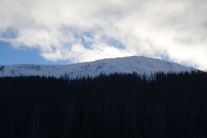 <b>Figure 2:</b> Looking up at South Diamond Peak, NE face, from the highway. The entire face slid on 12-24-2016. The avalanche propagated from the small island of trees on the right to the cliff band on the left. The avalanche was approximately 2,000 feet across with a vertical fall of approximately 900 feet. (<a href=javascript:void(0); onClick=win=window.open('http://avalanche.state.co.us/caic/media/full/obs_43762_14202.jpg','caic_media','resizable=1,height=820,width=840,scrollbars=yes');win.focus();return false;>see full sized image</a>)