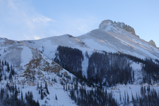 <b>Figure 9:</b> Looking south from Highway 14 toward the Nokhu Crags. In the center of the photograph you can see a natural avalanche that released sometime on 12-23-2016. The avalanche propagated across both of the shoots in the center of the screen. Steep north through northeast to east-facing with previous wind loading like this are areas you should avoid right now. (<a href=javascript:void(0); onClick=win=window.open('http://avalanche.state.co.us/caic/media/full/obs_43762_14209.jpg','caic_media','resizable=1,height=820,width=840,scrollbars=yes');win.focus();return false;>see full sized image</a>)