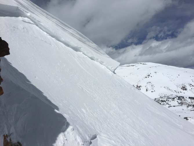 <b>Figure 1:</b> Looking across the crown of an unintentional skier-triggered avalanches on Mt. Parnasssus 4/8/2017. (<a href=javascript:void(0); onClick=win=window.open('http://avalanche.state.co.us/caic/media/full/obs_46879_16636.jpeg','caic_media','resizable=1,height=820,width=840,scrollbars=yes');win.focus();return false;>see full sized image</a>)