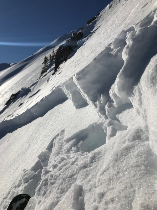 <b>Figure 9:</b> Propagated into older snow. crown here is fist, older snow and facets. Soft and not loaded here. 1' light crust on surface from last two days sun. this is about 200' away from start/trigger point. I believe the snow structure is similar however the strength in the structure here is much less than at trigger point. New drifted snow from the last couple days maybe only 6&quot; at trigger point. Little drifted snow here at photo. Snow blown off here despite same aspect. Yet very soft 12&quot; remaining here. Very complicated wind/rotar paterns all the way along this ridge from TL to summit. Windiest points along ridge do not increase proportionately with elevation. it is windy lower with consistently much less wind effect in a few higher places along ridge. Then stronger wind effect near summit. (<a href=javascript:void(0); onClick=win=window.open('https://avalanche.state.co.us/caic/media/full/obs_54287_24112.jpg','caic_media','resizable=1,height=820,width=840,scrollbars=yes');win.focus();return false;>see full sized image</a>)