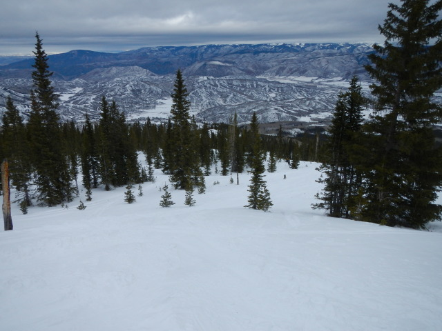 <b>Figure 1:</b> Looking down the terrain that leads to the accident site on Burnt Mountain. Owl and Brush Creeks are at the valley floor in the distance. (<a href=javascript:void(0); onClick=win=window.open('https://avalanche.state.co.us/media/full/acc_431_1804.jpg','caic_media','resizable=1,height=820,width=840,scrollbars=yes');win.focus();return false;>see full sized image</a>)